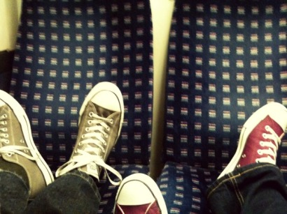 His and Hers sneakers on the train